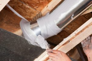 hand-sealing-up-ductwork