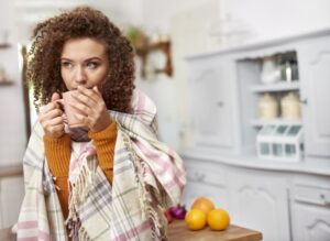 woman-wrapped-in-blanket-drinking-out-of-mug