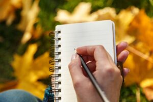 woman-hand-writing-in-notepad